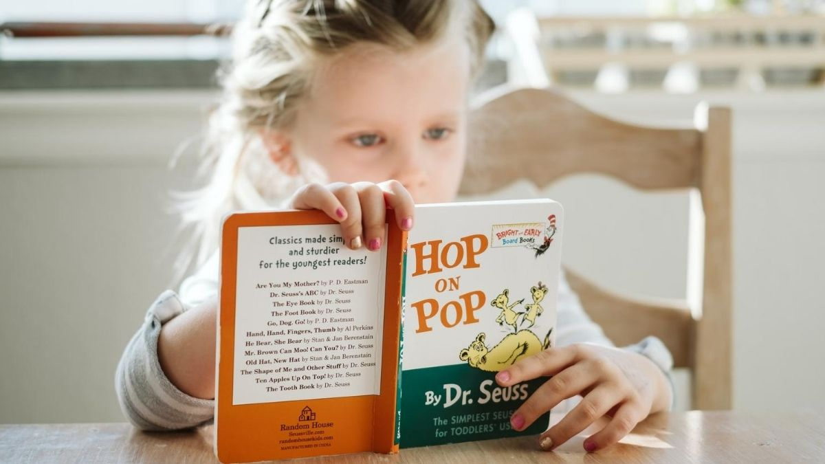 image of girl reading a rhyming book Hop on Pop phonemic awareness